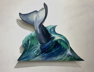 Whale Tail Descending into a Wave