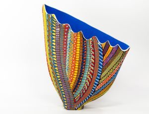 """A Coat of Many Colorshand painted ceramic; 14""""h x 13""""w x 5""""d"""
